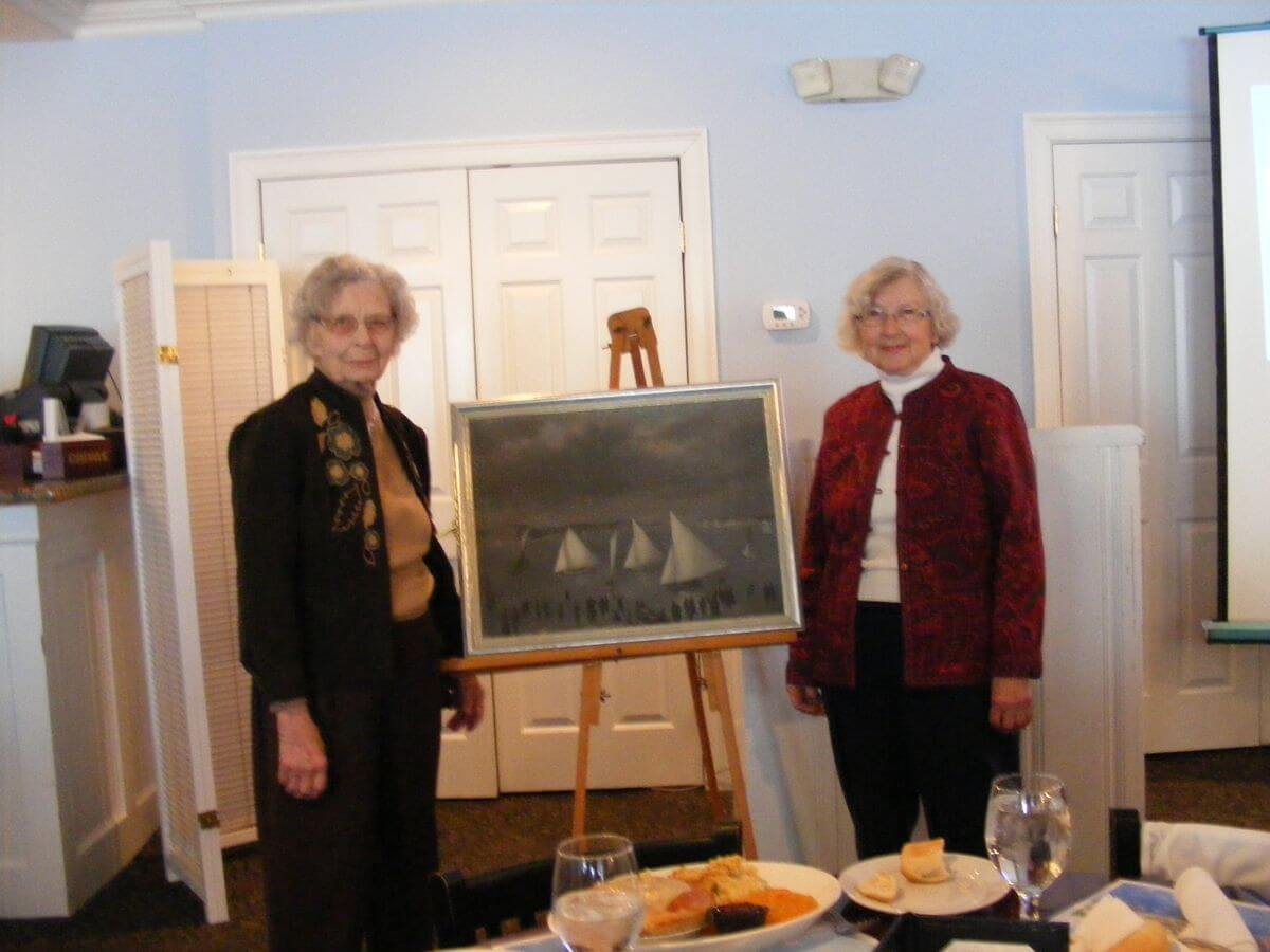Emily Lindberg and Jeannette Louth donate a painting